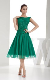 Knee Length Bateau Ruched Criss Cross Dress With Tulle Overlay and Beadings