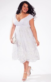 A-line Tea-length Lace Dress With Ruching And Low-V Back
