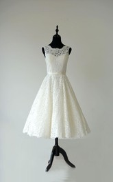 Sleeveless A-Line Tea Length Lace Dress With Low-V Back and Satin Sash